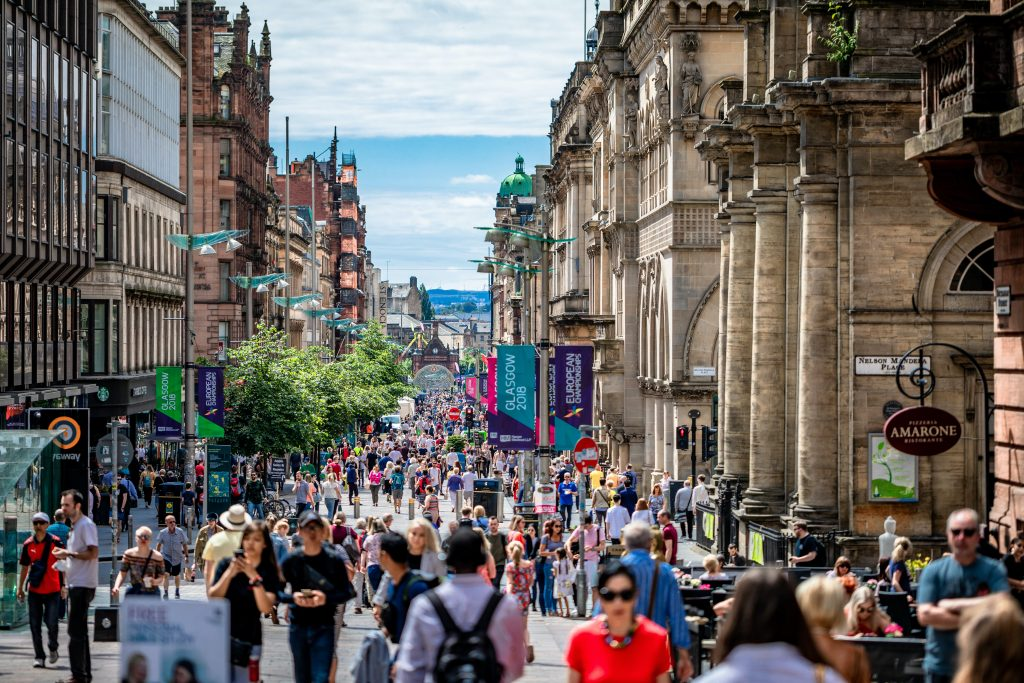 High street shoppers on a busy street in Glasgow summer 2018